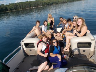 Group on the Conserve School pontoon boat