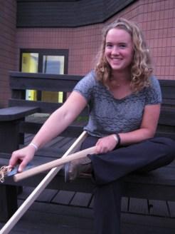 Olivia carves her cedar sticks with ease.