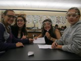 Melissa, Carly, Clara, and Sara working on their labsheet.