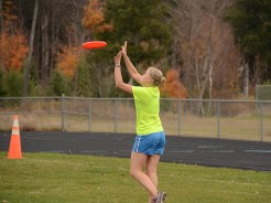 Emily and the Green team warm up before the Ultimate Frisbee game