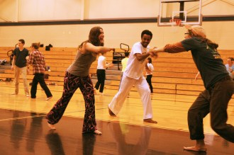 "Kristi practices her ginga with Grad Fellow ""Fiskars"" under the instruction of Gustavo, a guest Capoeirista."