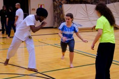 Kaya and Chloe practice their ginga with Capoeirista Demetrius. Ginga is the most important movement of Capoeira.