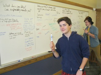 """Liam and Logan wrap up a few thoughts from a chalk talk on activism during """"Gather Go Grow""""."""