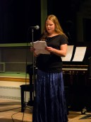 Katelynn reads a poem at the open mic night