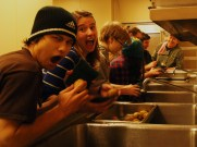Conner and Chloe have some fun while helping to peel potatos