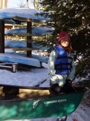 Shelie helps load her canoe