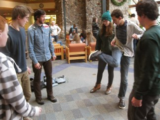 Ellie, Henry, Logan and Grad Fellow Andrew enjoy a game of hackysack before lunch.