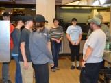 Scott preparing students for their kitchen tasks