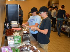 Ruby and Jeremy making jerky for Exploration Week