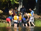 Emptying water from the canoe