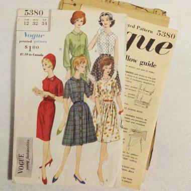 Vintage Vogue sewing pattern envelope with illustration of five women wearing dresses