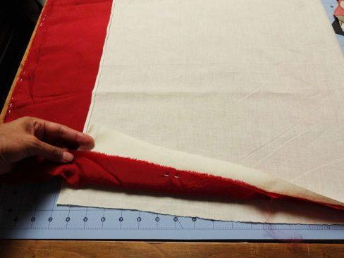 Sandwich lining fabric between muslin
