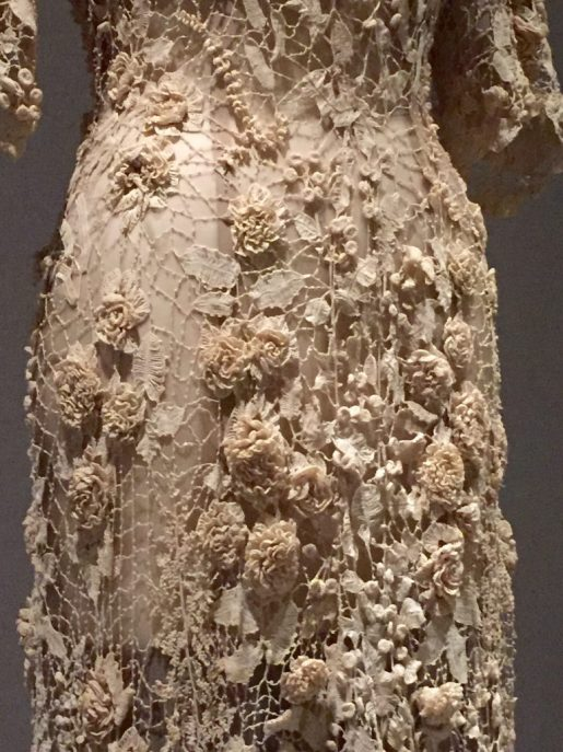 Manus x Machina - Detail - Irish wedding dress, ca. 1870 - hand-crocheted cotton lace with three-dimensional motifs (roses, lilies of the valley, hanging fuchsias, morning glories, buds and berries, and flat and folded leaves and ferns)
