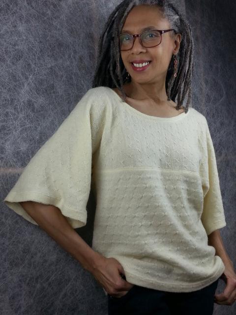Olgalyn Jolly wearing a Saint Cloud sweater knit