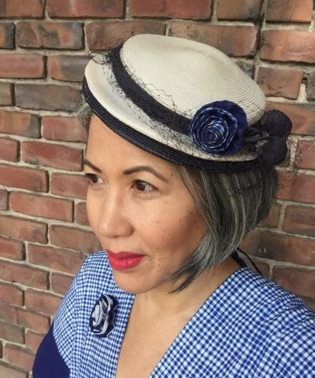 Hat embellished with a fabric flower