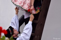 Girl and boy in folklore dress in Holloko, Hungary, Easter festival