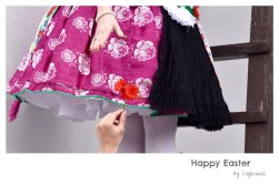 Girl in traditional Hungarian folklor dress at Holloko Easter festival in Hungary