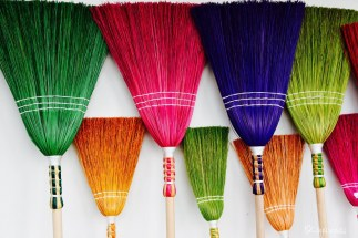 Colored sweepers at Holloko Easter festival in Hungary