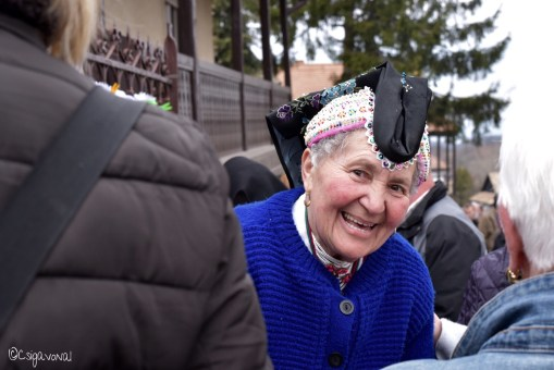 Documentary portrait of old lady in folklor dress. Taken at Easter festival in Holloko, Hungary