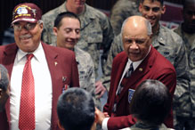 Retired Col. Lowell Bell (left) and retired Chief Master Sgt. Loran Smith enjoy the company of cadet candidates during their visit as members of Hooks Jones chapter of the Tuskegee Airmen, Inc.