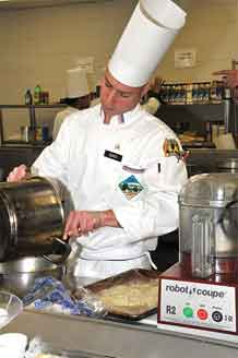 (Photo by Kimberly Fritz Fort Lee) Sgt. Anthony Santi competes for the title of Armed Forces Chef of the Year during the 34th U.S. Army Culinary Competition March 3, 2009 at Fort Lee, Va. Santi is a member of the Fort Carson, Colo. team.