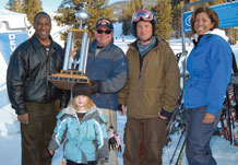 "(US Air Force photo by Mr. Warren Schroeder) Col. Jimmy McMillian, 10th Air Base Wing commander stands with snowboarder, Maj. John Thomas, Air Force Operational Test and Evaluation Center, Det. 4 and his daughter Abigail; snowboarder Erin O""Connor, retired Air Force, and Col. Emily Buckman, 21st Mission Support Group commander Jan. 30 at SnoFest in Keystone. Colonels McMillian and Buckman accepted the SnoFest Cup on behalf of Peterson Air Force Base. Peterson AFB won the event with the fastest combined snowboard and ski times."