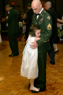 Staff Sgt. Benjamin LeBeau dances with his daughter Briteni, 8, at the Young Men's Christian Association Father Daughter Dance Friday.