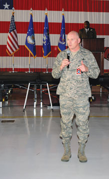 "(Air Force photo by Craig Denton)  Col. Scott Gilson, Air Force Space Command Inspector General, announces the 21st Space Wing's operational readiness and unit compliance inspection results in Hangar 140 here April 21, 2009. ""I've never seen a wing tested the way you were. You did a marvelous job,"" said Colonel Gilson. Peterson received a ""Satisfactory"" rating following a 33 day inspection by a 109 member IG team. According to Colonel Gilson, Peterson's ORI was the largest AFSPC inspection to date."