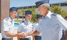 U.S. Air Force Academy Superintendent Lt. Gen. John Regni visits with cadets on the Terrazzo. The general has served as the Academy's leader since October 2005. (File Photo)