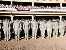Rodeo fans cheer Fort Carson Soldiers as they stand in formation during prerodeo festivities.
