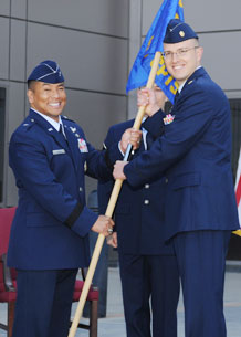 Maj. Thomas Smicklas accepts the 50th Comptroller Squadron guidon from Brig. Gen. Cary Chun, 50th Space Wing commander, in a change of command ceremony, July 17. Major Smicklas assumed command of the squadron from Maj. Christopher Abate, who was the wing comptroller since June 2006.
