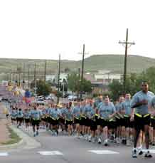 Photo by Sgt. Philip Klein.  Soldiers from the 4th Infantry Division and Fort Carson run Titus Boulevard during the 4th Inf. Div. and Fort Carson run Sept. 11, commemorating the eighth anniversary of the Sept. 11 attacks.