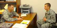 Sgt. 1st Class Daniel Andreas, 1st Battalion, 22nd Infantry Regiment, 1st Brigade Combat Team, 4th Infantry Division, discusses the benefits of the Deployment Extension Incentive Program with Spc. Blake Cramer, infantryman, Company B, 1st Bn., 22nd Inf. Reg., 1st BCT, 4th Inf. Div. Andreas was the winner of The Mountain Post Career Counselor of the Year Board.