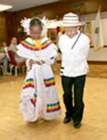 Stephany Fennell, left, and Joshua Mike perform a Panamanian dance at the Hispanic Heritage Month observance Sept. 23 at Elkhorn Conference Center.