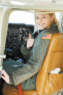 Hannah Marklin gives thumbs up as she prepares to depart in Cessna. Photo by Bill Evans