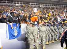 Photos by Walt Johnson.  Mountain Post Soldiers accept congratulations from football fans as they enter Invesco Field at Mile High in Denver Nov. 9 to take part in halftime ceremonies during the Pittsburgh Steelers versus Denver Broncos Monday Night Football game.