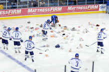 "Air Force Falcons hockey players rein in toys from the ""Toy Trick"" after the Falcons scored their first goal of the game against American International College at the Air Force Academy's Cadet Ice Arena Saturday. Photo by J. Rachel Spencer"