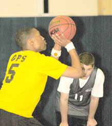 Kion Shaw, 2nd Space Operations Squadron team captain, attempts a free-throw during the second half of 2 SOPS' 49-39 win over 50th Comptroller Squadron Dec. 1.