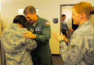 Staff Sgt. Lisa Head, 50th Force Support Squadron, gets emotional when she learned she was promoted to technical sergeant through the Stripes for Exceptional Performers Program by Col. Wayne Monteith, 50th Space Wing commander, Dec. 23. (U.S. Air Force photo/Jennifer Thibault)