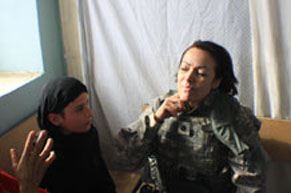 Lt. Col. Montserrat Edie-Korleski works alongside Army medics to treat a child in Afghanistan.  Courtesy photo