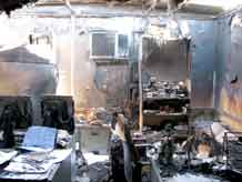 Courtesy photo.  A building shows the results of an electrical fire, one of the many examples of why Jeff Morris, a Fort Carson contractor, took a job in Iraq.