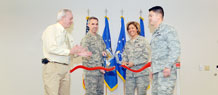 (From left) Mr. Larry Wilkerson, Peterson Air Force Base Installation Deployment Officer, Col. Stephen N. Whiting, 21st SW commander, Col. Emily Buckman, 21st Mission Support Group commander, and Maj. Jerry Gonzalez, 21st Logistics Readiness Squadron commander, cut the ceremonial ribbon at Building 123 during the Jan. 22 LRS deployment facility re-opening ceremony. (Air Force photo illustration by Rob Bussard)