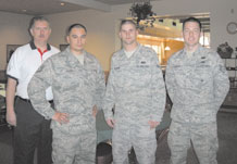 Air Force Reservist Staff Sgt. Christopher Whigham of the 302nd Services Flight (far right) along with (from left to right) Mr. John Karagiannes, Tech. Sgt. Rick Rayos and Airman Ross Belknap all from 21 Space Wing Force Services Squadron were the first responders to a local bread delivery man who collapsed while making a delivery to Aragon Dining Facility at Peterson Air Force Base, Colo. on Feb. 1. Sergeant Whigham used the life-saving skills he learned on his civilian job as a police officer with the Albuquerque, N.M. police department to perform CPR. (U.S. Air Force photo/Ann F. Skarban)