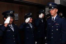 Cadets 2nd Class Jennifer Walters and Lacey Richardson, along with others from Cadet Squadron 18, salute Cadet 4th Class Dan Derby during Recognition at the Air Force Academy Saturday. Photo by Mike Kaplan