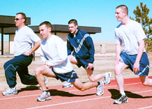Members of the 50th Comptroller Squadron stretch prior to running at the base track March 16.  (U.S. Air Force photo/Scott Prater)
