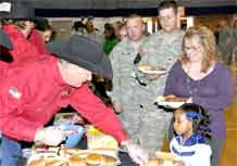 Keith Overland, a volunteer with the All-American Beef Battalion, serves Family members of the 4th Engineer Battalion.