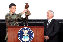 "Cadet 1st Class Andrew J. VanTimmeren, Cadet Wing commander, presents the U. S. Secretary of Defense Robert Gates with ""The Bird"" after addressing the Cadet Wing in Arnold Hall theater April 2.  Photo by Johnny Wilson"