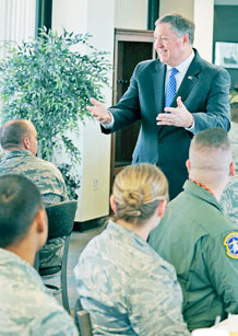 Secretary of the Air Force Michael Donley, fields questions from various members of Team Schriever during a lunch with Airmen on April 13. (U.S. Air Force Photo by Dave Ahlschwede)