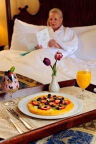 A breakfast-in-bed tray for Mother's Day includes a breakfast pizza, granola-and-yogurt parfait and orange juice. Photo by K.C. Alfred