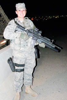 Airman 1st Class Jessica Hill, 387th Expeditionary Security Forces Squadron entry controller, guards the entrance to an undisclosed air base in Southwest Asia March 31, 2010. (U.S. Air Force photo by Capt. Mollie Robinson)